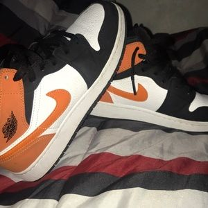 Orange and black Jordan 1s
